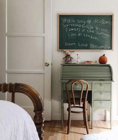 Painted rolltop desk in child's bedroom....Love the old chalkboard on the wall.