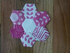 Hexie flower I made to applique on baby quilt.     Tutorial from.here http://beeinmybonnetco.blogspot.com/2011/02/almost-wordless-wednesday-playing-with.html?m=1