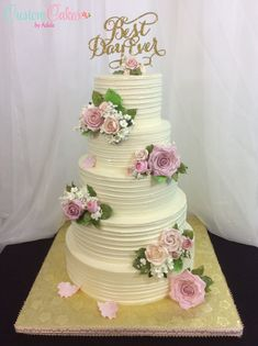 wedding cake with pink sugar roses