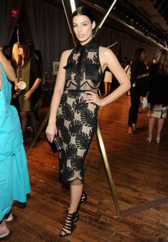 Jessica Pare donned a Jason Wu Resort 2014 lace overlay illusion dress at the designer's S/S 2014 show, perfectly encapsulating his elegant, feminine aesthetic.