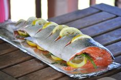 Brian's grilled whole salmon before, but this has a couple of hints that might make it even easier. grilling a whole salmon Whole Salmon Recipe, Coho Salmon Recipe, Whole Fish Recipes, Best Grilled Salmon Recipe, Baked Salmon Recipes, Seafood Recipes, Cooking Recipes, Healthy Recipes, Bbq Salmon In Foil