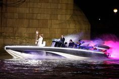 LONDON Olympics - David Beckham driving a speedboat, carrying the Olympic Torch, under Tower Bridge.