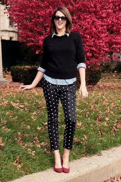 Black pants with white polka dots, Denim shirt under a black sweater.  Finished with RED pumps!