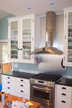 Custom Kitchen - the SS backsplash for the stove and exhaust hood is pretty awesome