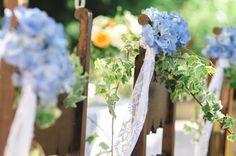 Matrimonio country chic con edera e rami di ulivo