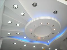 Sophisticated Blue LED Lighting for Fall Ceiling Designs on White Ceiling in Modern Room