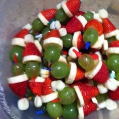 Grinch kabobs - grape, banana, strawberry, marshmallow. Dust with powdered sugar for a snow effect