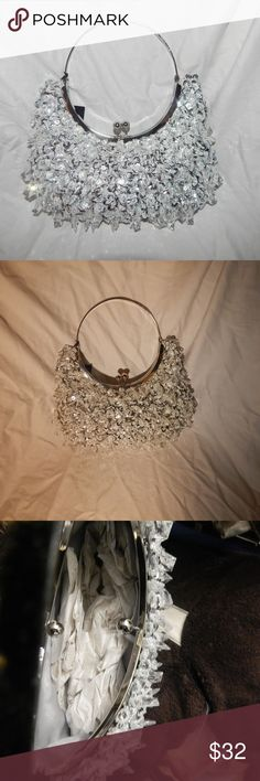 NWT Harve Benard Evening Bag Chandelier Style Brand New  evening bag with beautiful crystal beads and sequins all over the bag. Adjustable curved handle so you can decide how you want to ware the bag. Great for an evening out. A true show stopping bag. Stunning look. Perfect for any fashion statement. Satin material on the inside with an extra pocket for storage if needed. Easy to open and close. Harve Benard Bags Mini Bags