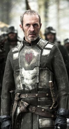 Stannis Baratheon wearing plate over chain armor, played by Stephen Dillane on HBOs The Game of Thrones. His sigil, a flaming red heart with the stag of House Baratheon. Winter Is Here, Winter Is Coming, Stephen Dillane, Got Merchandise, Got Costumes, Got Characters, Got Game Of Thrones, Game Of Trones, Book Series
