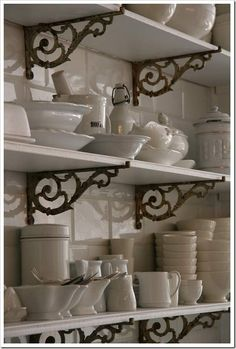 shelves. i dig these. I can so picture a kitchen with grey walls and yellow or salmon shelves.