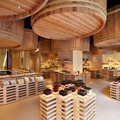 Kengo Kuma suspends wooden barrels over Japanese soy-sauce shop