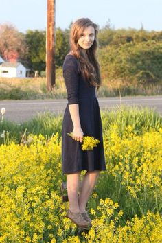 Navy Blue Dress, field of yellow flowers