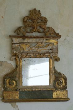 A do-it-your-selfer, salvaged mouldings and trims reused to create this simply, yet ornate piece.