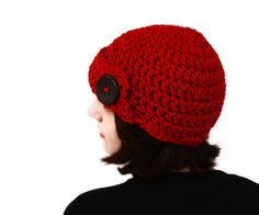 Red Bulky Skullcap with Big Black Button. $28,00, via Etsy.