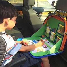 We're hopeful this will keep your Picasso's crayons from rolling onto the car floor. Not only is it great for coloring, but it also provides a hold an iPad or Kindle secured to the back seat for easy viewing.