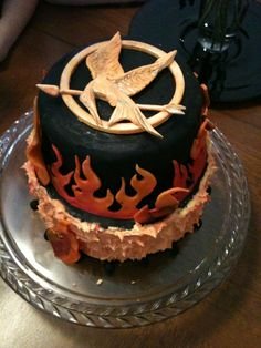 +-+Hunger+Games+cake+for+my+daughter's+birthday.++Pin+was+gumpaste,+flames+were+fondant.