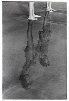 Elliott Erwitt | reflections in the water | at the beach | friendship | siblings | composition | brilliant black & white vintage photography | feet