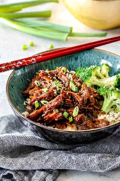 Slow cooker Pulled Pork in green bowl with chopsticks