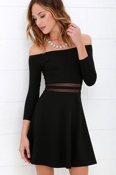 We think you will agree that the Yes to the Mesh Black Skater Dress will be worth a night out (or two)! Elastic off-the-shoulder neckline introduces fitted half sleeves alongside a darted bodice. Bands of sheer mesh accent the waist while a skater skirt creates a fantastic finish below. Hidden side zipper.
