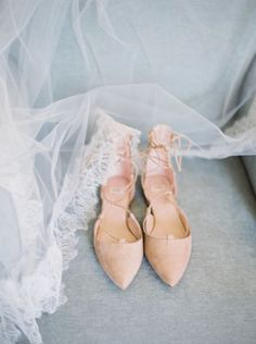 Nude pointed toe lace up flats: Photography : Lauren Fair Photography Read More on SMP: http://www.stylemepretty.com/2016/12/28/a-wedding-that-fully-embraces-spring/
