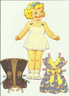 I spent HOURS playing with.....and making my own paper dolls!