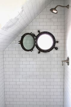 reclaimed Porthole window in the shower