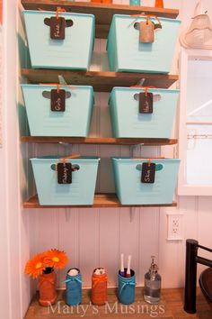 Small Bathroom Remodel from Marty's Musings. Love these dollar store baskets and chalk paint tags!