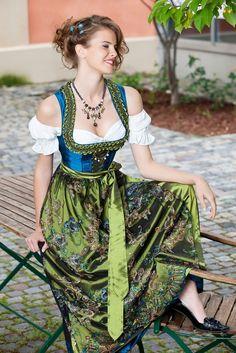 A breathtaking jewel toned dirndl from Angermaier Tracht. #tracht #dirndl #dress #German #folk #costume #green #blue by Ирина Дубровская
