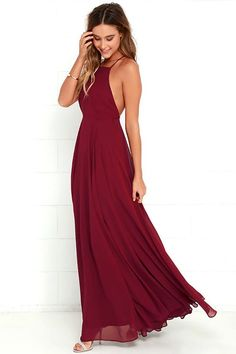 Create a moody vibe with an ensemble of deep maroon floor-length gowns.
