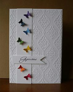 Those tiny bright butterflies on the plain panel with the embossed background create a strikingly simple yet beautiful card.