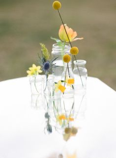 Yellow centerpieces | Style Me Pretty