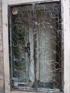 Creative metal window Eastern Europe. Photographed by Marleen van de Kraats, no photoshop or paint etc.