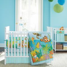 Baby Nursery Celebrities' Baby Nursery Room You Can Get Inspired from: Baby Nursery Celebrity Design With White Wooden Baby Crib Blue Wall Painted Nemo Cute Blanket Green And Blue Beautiful Lanterns White Curtain Multipurpose Storage Made From Wood