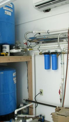 Rainwater collection filtration system.  /  Blue Horse Building + Design / Alterstudio Architects LLC / Lighthouse Solar of Austin /