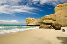 Image of Tunnel Beach | Blue Sea | Blue Sky | White Clouds | People | Otago Coast Dunedin South Island
