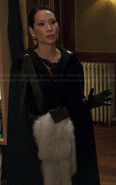 Joan's long black hooded cape and fur stole on Elementary.  Outfit Details: http://wornontv.net/44924/ #Elementary