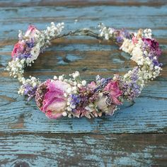 Our handmade dried flower hair crowns are a great alternative for creating a wild, bohemian look to your wedding. They are available in four styles.. 3/4 style as shown in the photos half crown with no flowers at the back only at the front and sides full crown with flowers all the way round no gaps half crown with comb They are made on a lightweight covered wire base, which will easily mould to the shape of the head with two loops at the back which can be easily adjusted. Our standard...