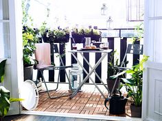 To make the most of a small patio space, use visually light furniture, like this folding table and chairs set.