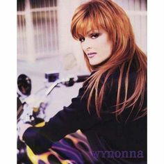Wynonna Judd - Motorcycle - I have met her several times, and WY really is Totally Cool.