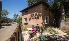 The post-earthquake prototype home was built for an elderly couple and as a demonstration project to show villagers how rammed earth construction can be modern, economical, and earthquake resistant.