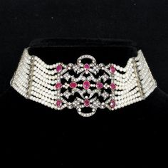 Edwardian collier de chien. 18 carat gold, silver, diamonds, rubies and pearls.