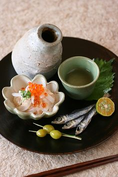 Sake and Cuttlefish sashimi with white gourd-melon and umeboshi dressing, Grilled dried sardine, Roasted ginkgo nuts