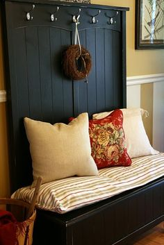 entry bench with cushion.  Cover cushion with washable covers.  White paint with hooks above and add mirror.
