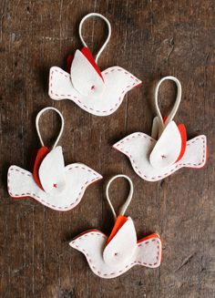 Felt Bird Ornament Kits from Purl Soho: Each kit makes 16 ornaments! Kit includes nine pieces of  8-inch x 12-inch wool felt (five ecru, and one each in four contrast colors), Valdani pearl cotton embroidery thread in two coordinating colors, a pack of John James embroidery needles, a Clover water soluable erasable fabric marker as well as full size templates, cutting diagrams and detailed instructions, all presented in a sturdy box you'll want to keep.    This kit makes the perfect gift for ...