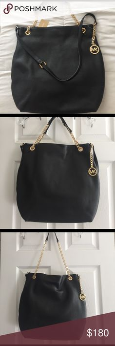 MUST HAVE! Michael Kors Tote This is a must have handbag by Michael Kors. It is large and versatile, very functional. Take a look at all the pictures and see the many possibilities you can wear this handbag, make it your own. MICHAEL Michael Kors Bags Totes