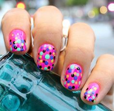 Colorful combination for your nail designs using a regular pink nail and adding multiple dots in different colors.