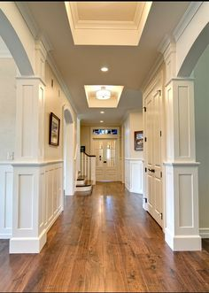 love the amazing trim work and the wood floors.