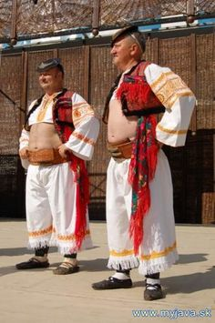 "Male folk costumes from town Detva and nearby areas (Podpoľanie region, Central Slovakia) are know for having extra short shirts that don't cover belly. That's why people wearing these costumes were called holopupkári - ""those with nude bellies""."