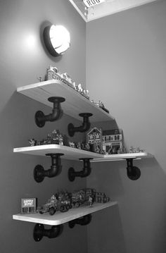 cool way to hang shelves for the boys trophies!