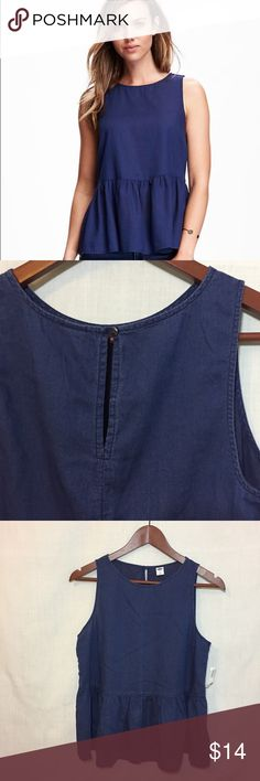 "NWT Old Navy Chambray Denim Peplum Sleeveless Tank NWT Old Navy Chambray Denim Peplum Sleeveless Tank  • Sz S • New with tags • 100% cotton • Unlined • Button closure at the back of your neck • Measured flat • 18"" bust •  23"" length including 8.5"" peplum  • 19"" waist, measured at peplum seam Old Navy Tops"